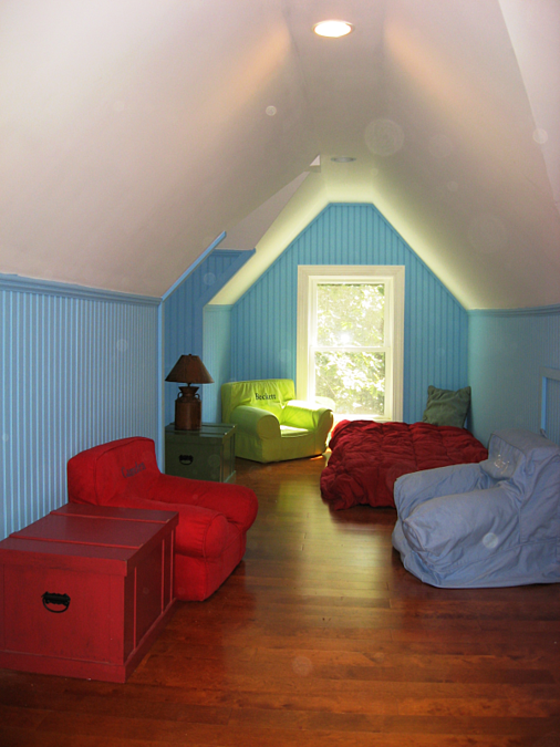 Attic view with recessed light in ceiling