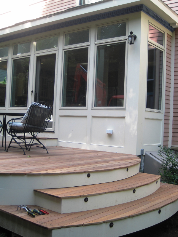 Curved stairs of new deck and addition